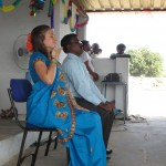 Researcher and S.H.E.L.T.E.R. co-founder Hanna Blaney teaches deep breathing and meditation to widows at the first self-help group meeting  (with Paul Raja Rao, Director of B.I.R.D.S., translating)
